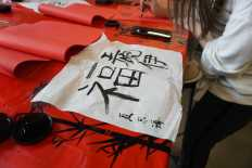 Students enjoy doing calligraphy. Photo by David Cutler.