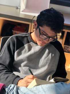 Stephen Moreno Jimenez '20 working on his English annotations. Photo by Sita Alomran '19.