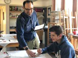 Brent Ridge helping Charlie Marconi '20 with his art work. Photo by Sita Alomran '19.