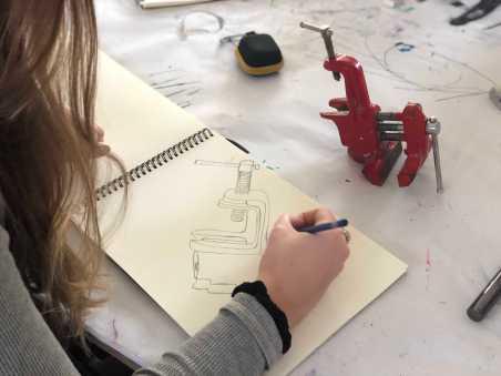 Student sketching a visual drawing. Photo by Sita Alomran '19.