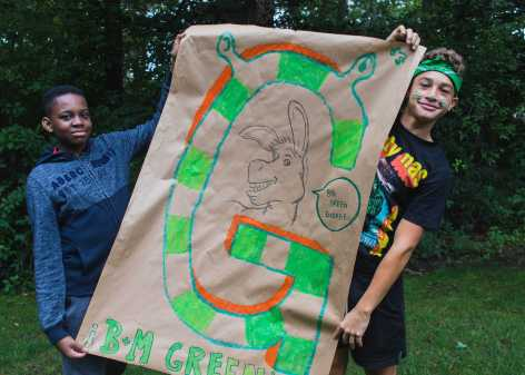 Ugo Adiele '23 and Owen Williams '23 cheer for the Green team during Color War. Their mascot is Donkey from the Shrek franchise.