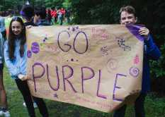 Madeline Hsiao '23 and Alexander Kirby '23 show team spirit on Team Purple.