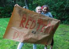 Eleanor Reyelt '23 and Talia Hammer '23 support their teammates on Team Red playing dodgeball.