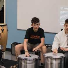 Kieran Cross '23 learns a new rhythm on the drums.