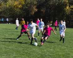Brian Barrera '22 takes the lead after the first kickoff in the Varsity Boys' Soccer game.
