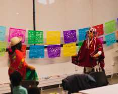 Nydia Comenzo '27 and her father demonstrate a traditional Ecuadorian dance.