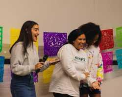 Sylvia Tejada, Emma Guevara, and Kaylee Little '23 introduce the Bachata dance.
