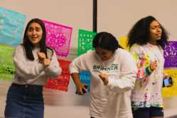 Freshmen Sylvia Tejada, Emma Guevara, and Kaylee Little jam out onstage.