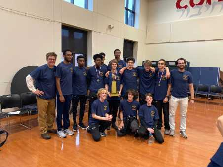 The boys' team poses with their new trophy championship shirts. Photo by Anja Westhues '19.