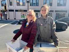 Nancy Bradley and Ella Meranus '20 walk to the Post Office with boxes of books. Photo by Edan Zinn '23.