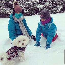Library Director Megan Dolan played in the snow with her children and her Maltipoo, Tito.