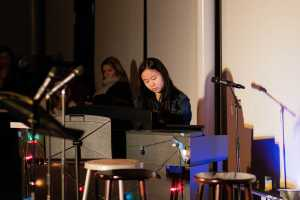 Kitty Huang '21 plays a song on the piano