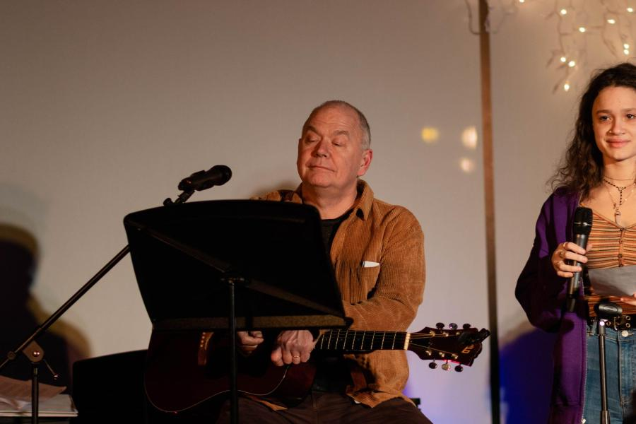 Creative Arts Department Chair Bill Jacob plays guitar during last year's Coffee House. Gator file photo.