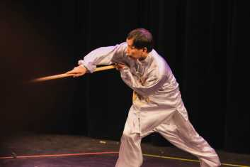 Director of International Students Helen Du's martial arts instructor does a form of Chinese martial arts.
