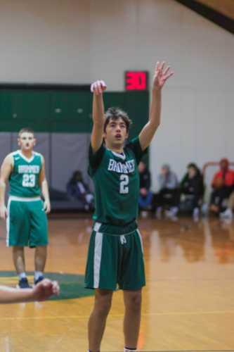 Asher Jaeckel '22 takes a shot on the opposing team's basket.