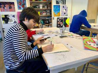 Marco Demelo '23 creates a sketch in Painting.