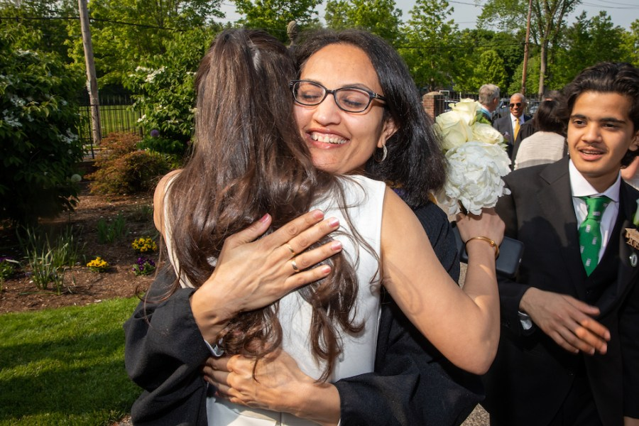 Sita Alomran '19 hugs math teacher Rupa Houndelga before last year's graduation ceremony. These final embraces will be missed this spring.