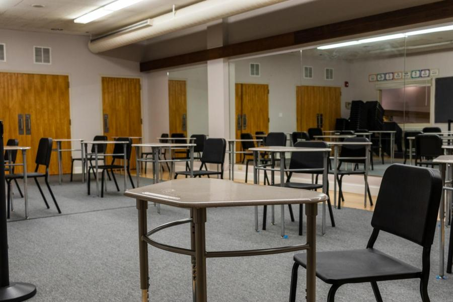 A classroom is set up with desks placed six feet apart. Photo Illustration by Edan Zinn