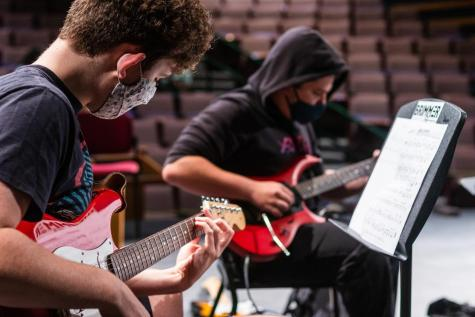 Kieran Cross 23 (front) and Jack Nathanson 23 play the guitar during a rehearsal. You can tell that everyone put in the effort this year to be able to play during COVID times, and I am grateful for having it at all this year, Cross said.