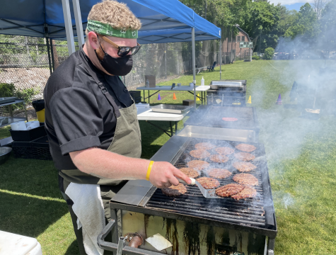 Head Chef Craig Roman mans the grill at the kitchen
