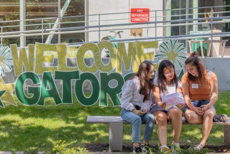 Madeline Hsiao 23, Hebe Qiang 23, and Libby Barker-Hook 23 sit outside on the first day of school.