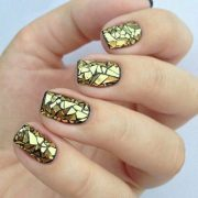 glamorous black and gold nail design