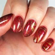 luminous red and gold nail design