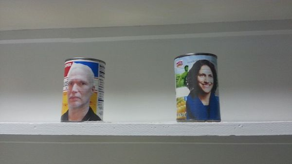 Images of Klaus Biesenbach and Regine Basha, displayed on canned goods. From the installation Midi-Midinette (Wernicke's Tune) by Grace Villamil, curated by Amanda Schmitt