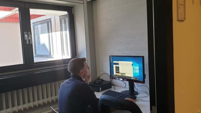 An inside look of Flexperiment room number 4 with its advanced eye-tracking system and hard-working BMS lab team member