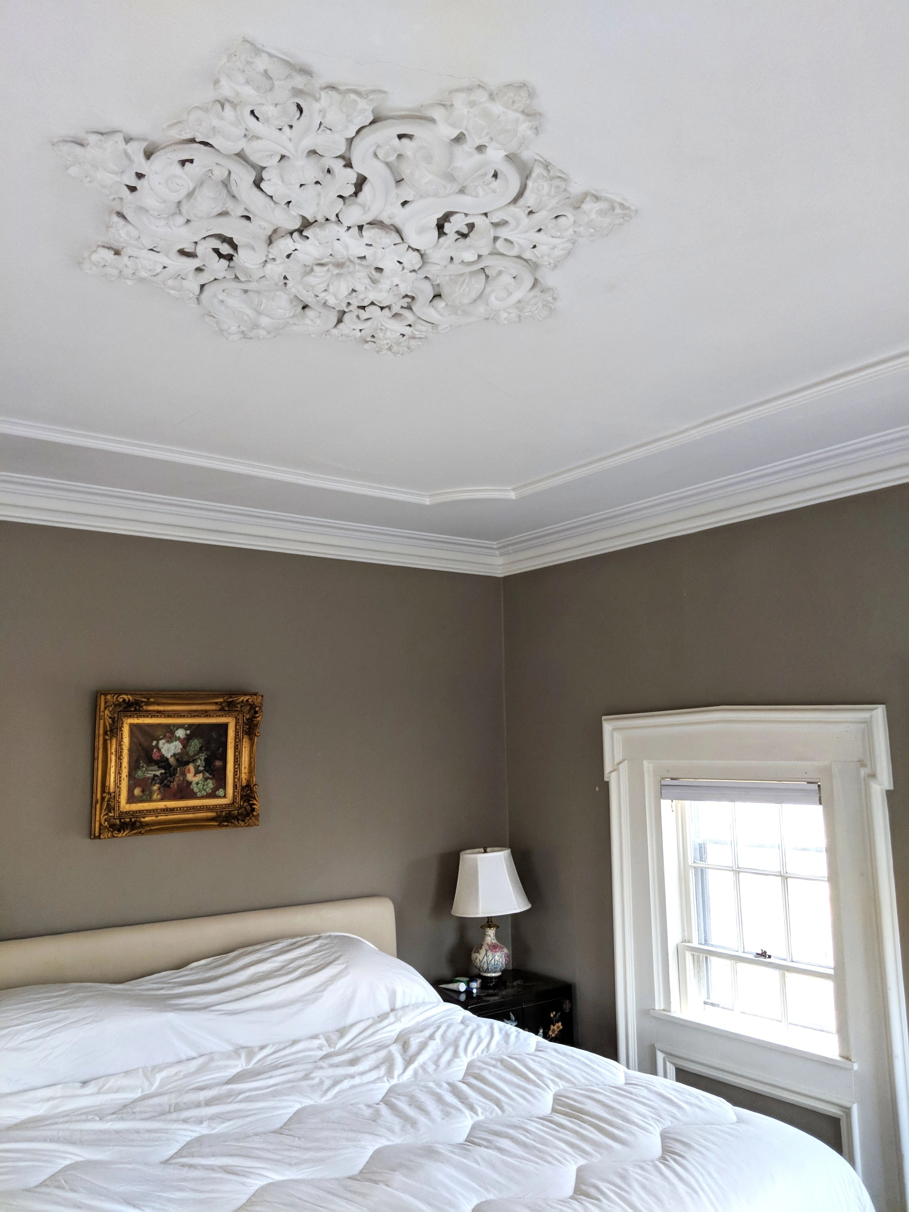 victorian bedroom with ornate ceiling