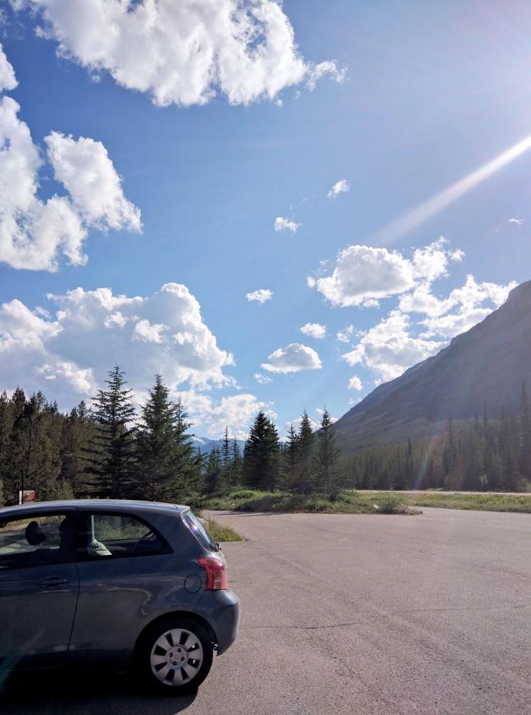 hatchback car in banff national park on a sunny day