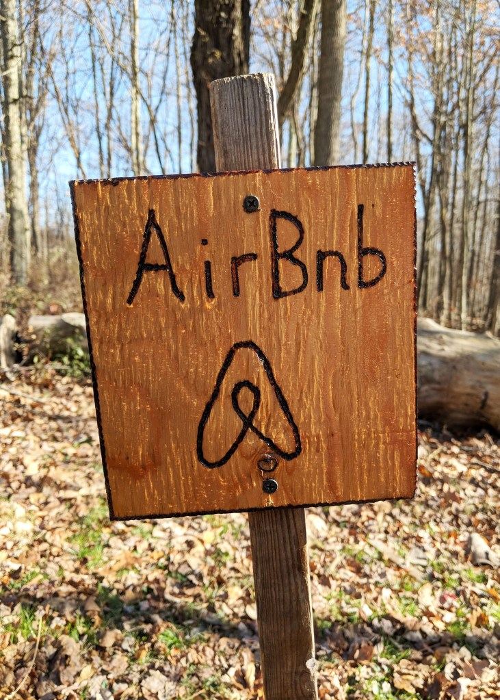 wooden parking sign with Airbnb on it