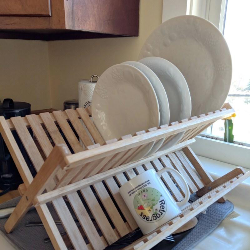 Drying Rack with plates and a coffee mug