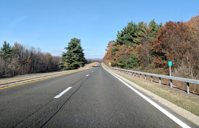 taconic state parkway with no cars and lots of fall leaves