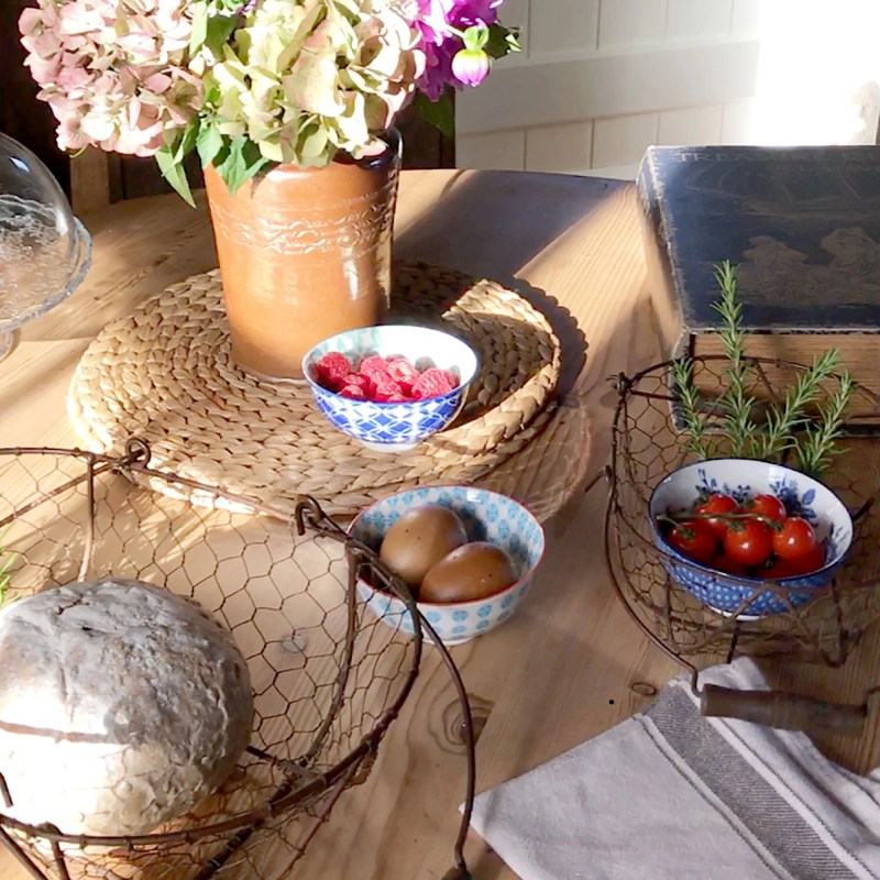 table with flowers, bread, cherry tomatoes