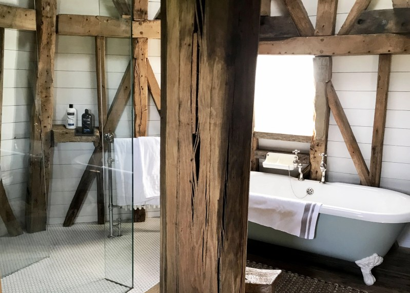 modern shower and tub in old windmill bathroom