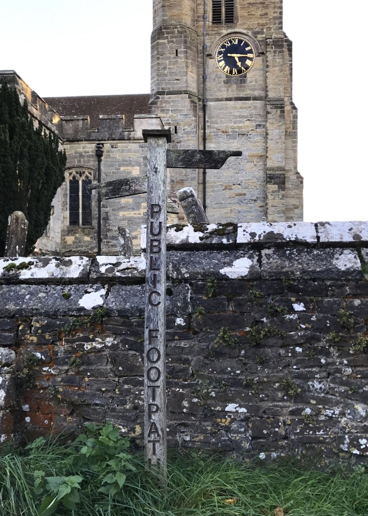 sign for public footpath outside church