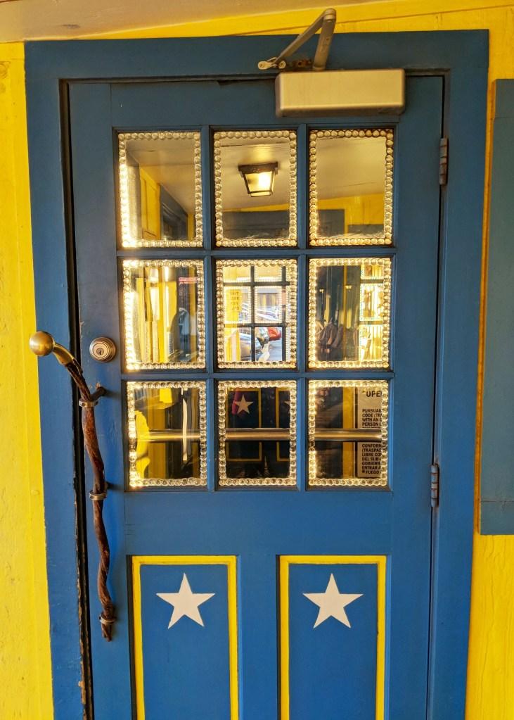 Blue and yellow door at the Big Texan restaurant