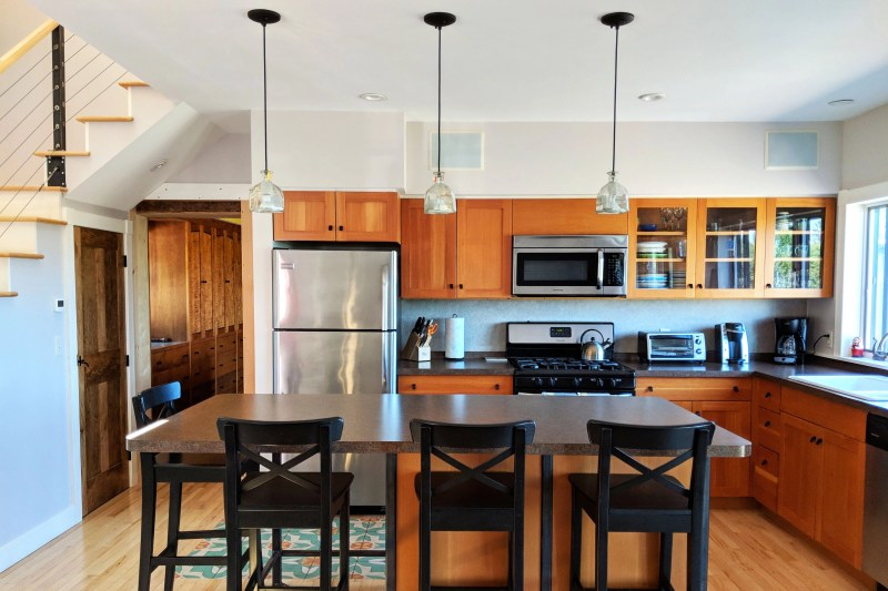 modern kitchen and stools at the Cherry Valley Farm Airbnb