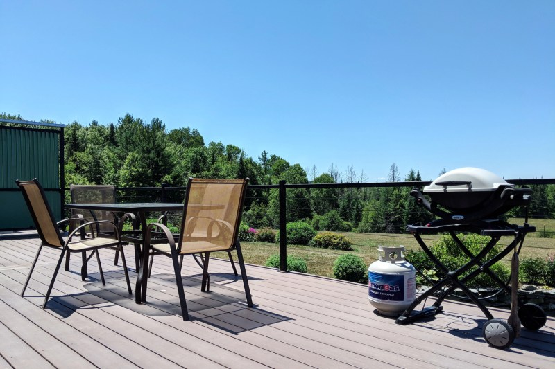 big porch with table and grill at Cherry Valley Farm Airbnb