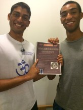 Shubham and Khalid with the flyer for the cookout