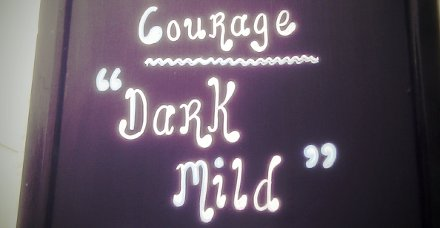 Sign outside a Plymouth pub advertising Courage Dark Mild