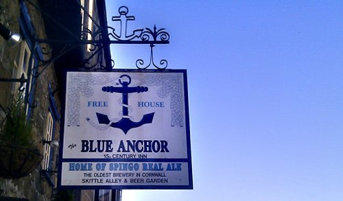 The sign of the Blue Anchor pub and brewery, Helston, Cornwall.