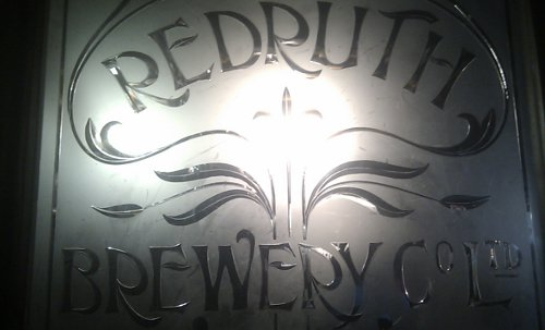 Edwardian glass screen advertising the Redruth Brewery Company Ltd