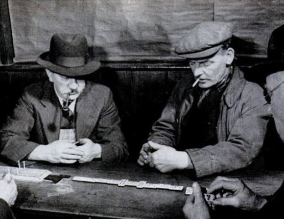 Dominoes in the pub, 1940.