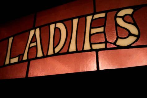 Ladies sign in a pub.