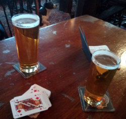 Cribbage in the pub with pints.