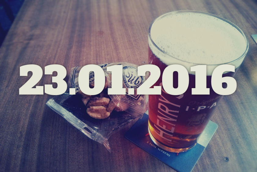A pint of beer and a bag of pork scratchings.