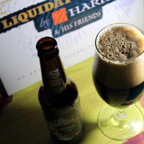 Chocolate Cake stout in front of a Harry J LP.