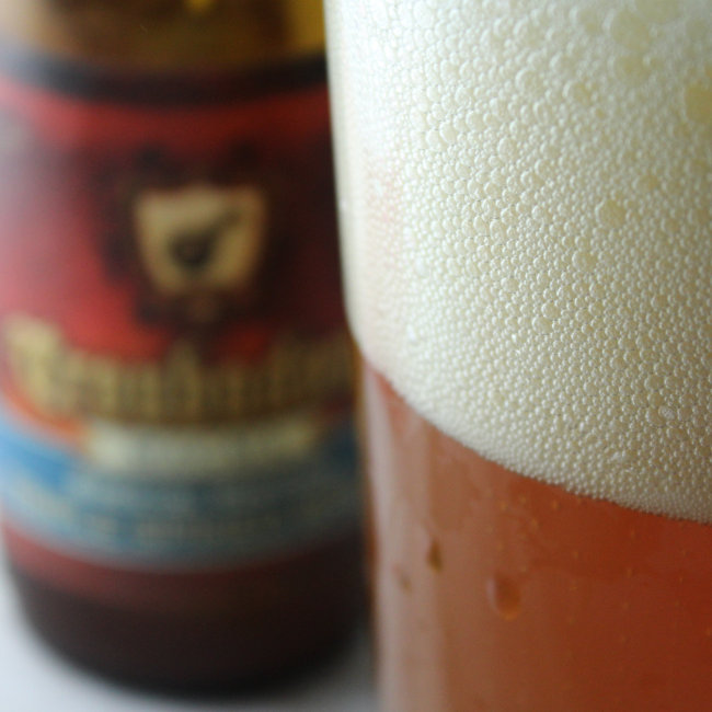 Close up on the foam of the beer.